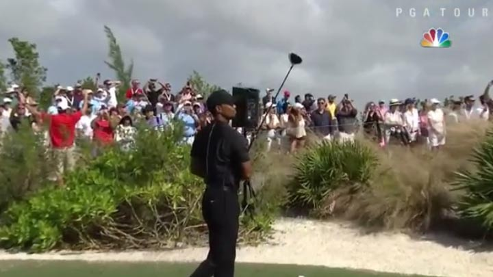 Tiger Woods watches his first tee shot during the first round of the Hero World Challenge.