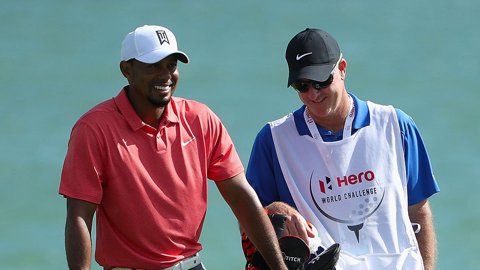 Tiger Woods stands with his caddie Joe LaCava on the 18th hole during the pro-am ahead of the 2016 Hero World Challenge at Albany, The Bahamas.