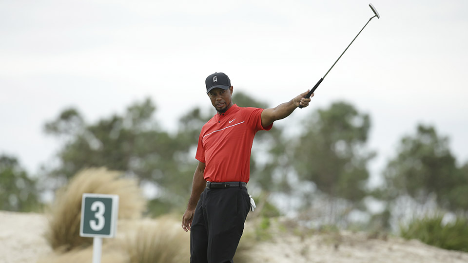 Tiger Woods reacts after putting on the third hole during the final round at the Hero World Challenge.