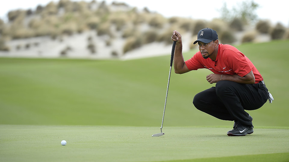 Tiger Woods studies his putt on the third hole during the final round of the Hero World Challenge.