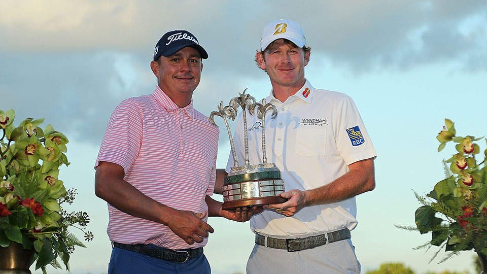 Jason Dufner and Brandt Snedeker pose with the trophy after winning the 2015 Franklin Templeton Shootout at Tiburon Golf Club.