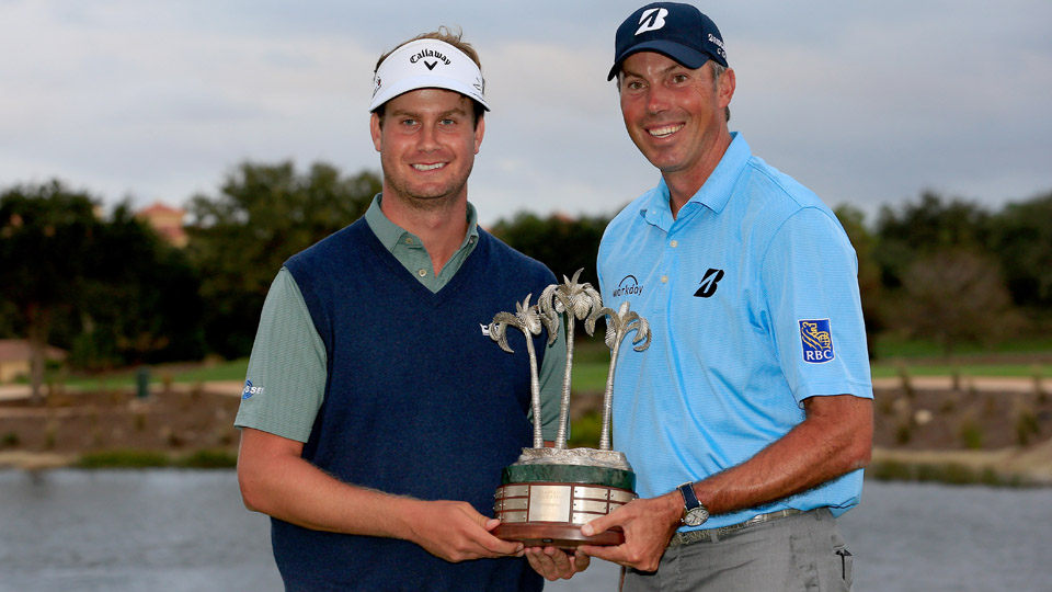 Harris English and teammate Matt Kuchar pose with the tournament trophy following their victory in the Franklin Templeton Shootout.