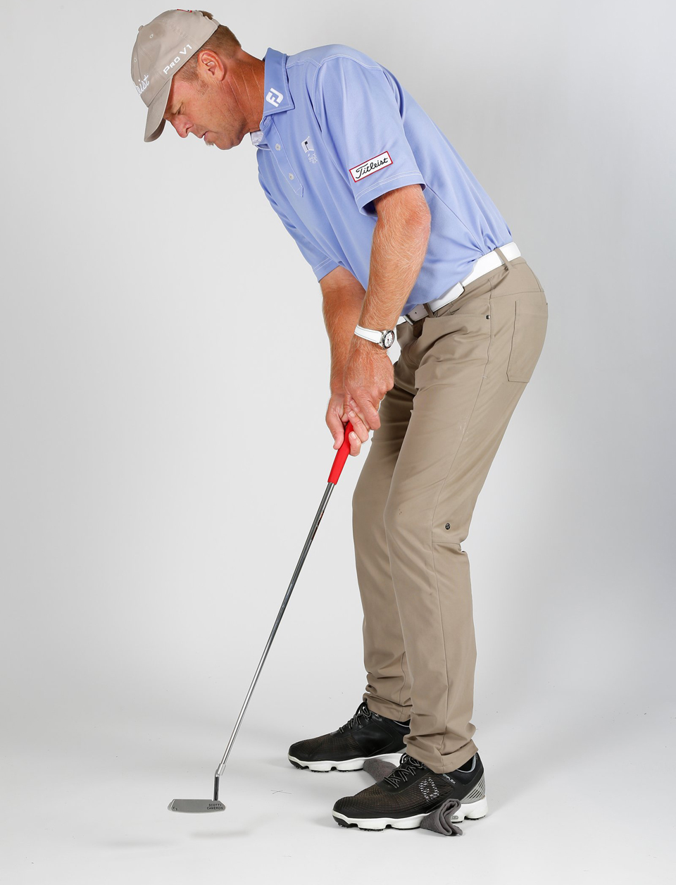 Putting while standing on a towel trains you to disassociate your upper-body movement from your lower—the key to stroke and face stability.