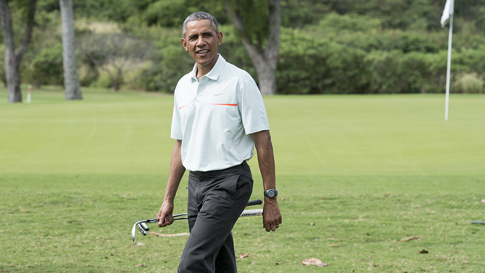 US President Barack Obama plays golf with Malaysian Prime Minister Najib Razzak at Marine Corps Base Hawaii on December 24, 2014.