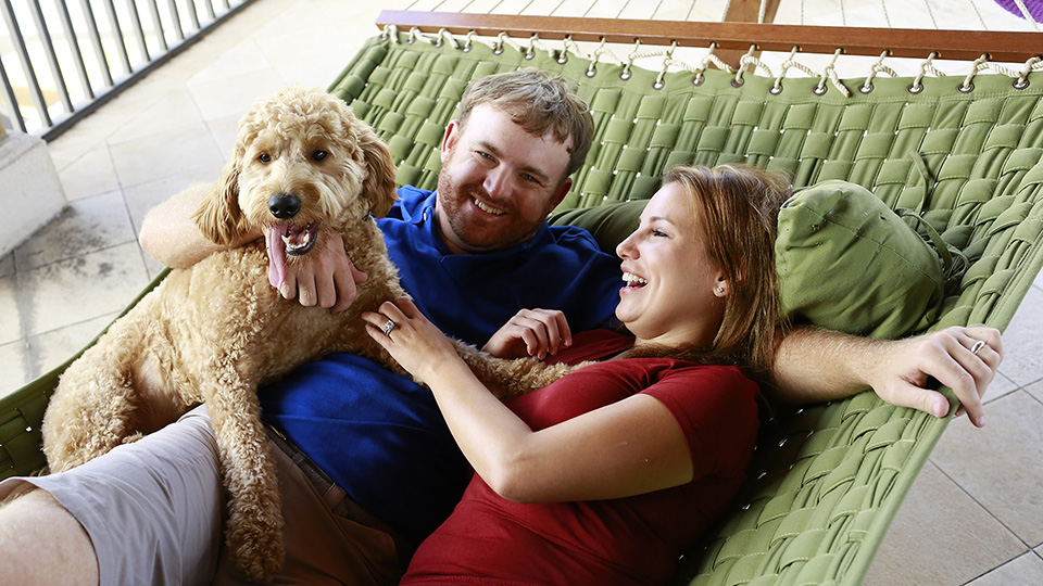 Holmes, with Erica and their dog, Ace. Erica thought J.B. was a club pro when they met, not a Tour pro.