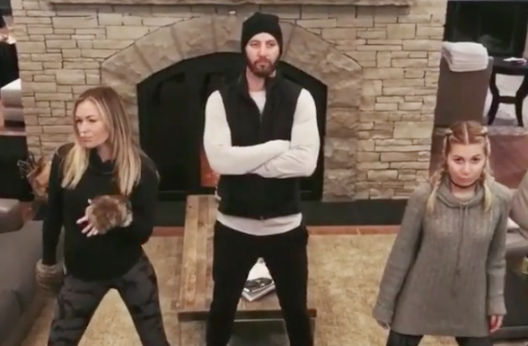 Paulina Gretzky (left) dances much more than Dustin Johnson (center) in their latest music video.