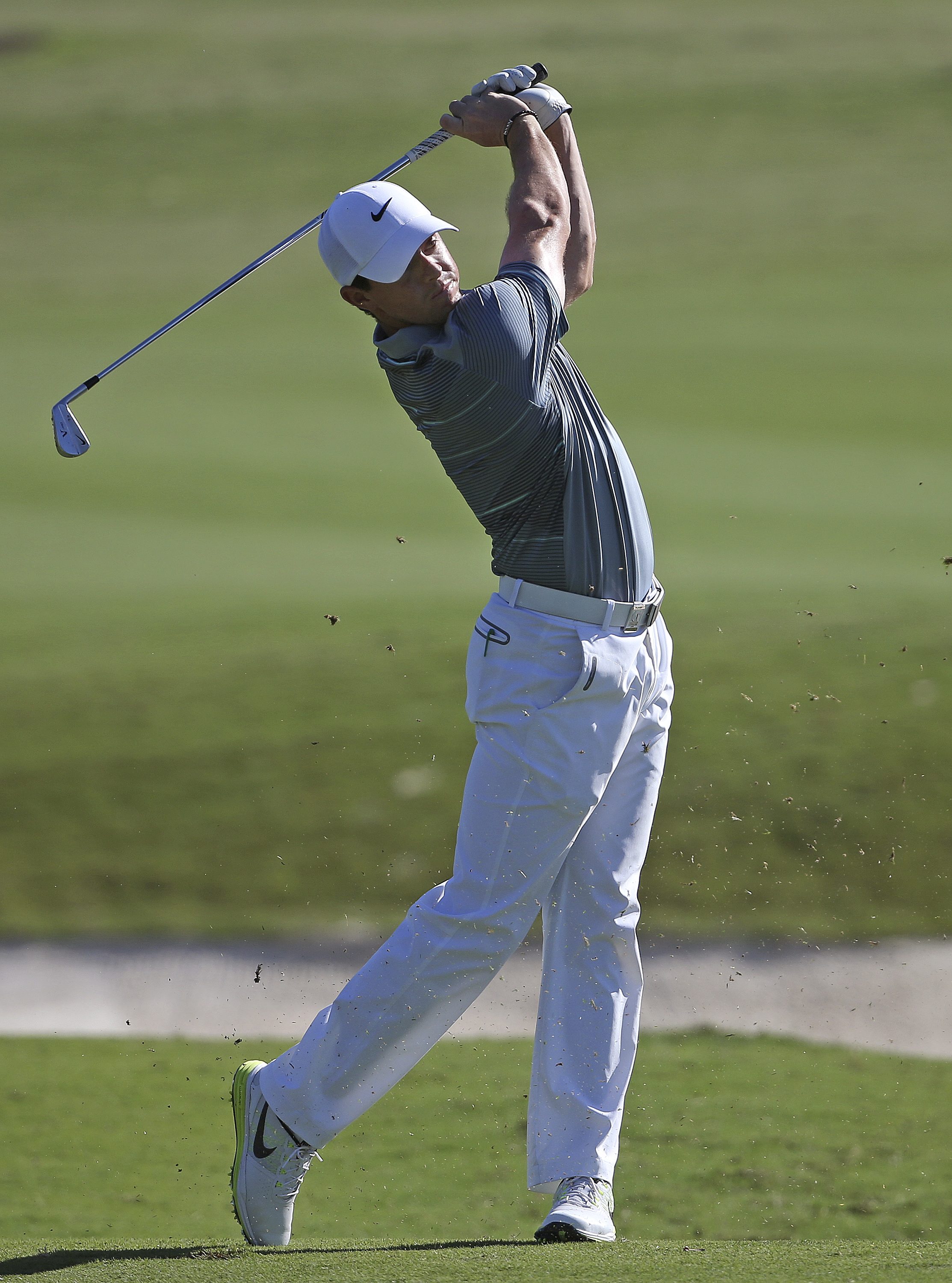 Northern Ireland's Rory McIlroy plays a shot on the 18th hole during the second round of the Australian Open Golf championship in Sydney, Friday, Nov. 28, 2014. (AP Photo/Rick