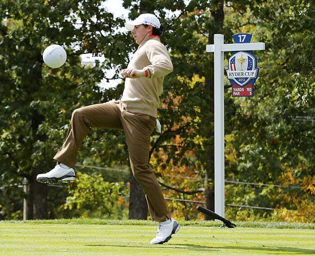 Team Europe golfer Rory McIlroy of Northern Ireland plays soccer with a large replica of a golf ball on the 17th tee during a practice round at the 39th Ryder Cup golf matches at the Medinah Country Club in Medinah, Illinois, September 27, 2012. REUTERS/Mike Blake (UNITED STATES  - Tags: SPORT GOLF)