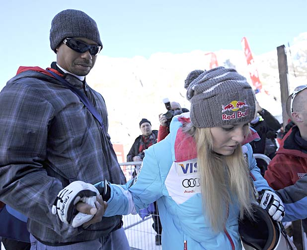 VAL D'ISERE, FRANCE - DECEMBER 21: (FRANCE OUT) Tiger Woods and Lindsey Vonn of USA during the Audi FIS Alpine Ski World Cup Women's Downhill on December 21, 2013 in Val d'Isere, France. (Photo by Michel Cottin/Agence Zoom/Getty Images)