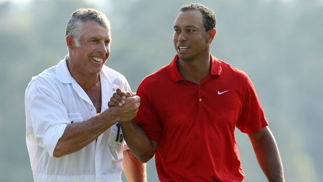 Tiger Woods walks off the 18th green with his caddie Steve Williams during the final round of the 2011 Masters Tournament.