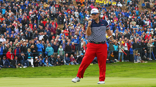 Patrick Reed celebrates a birdie putt on the 8th green on Sunday at the Ryder Cup.