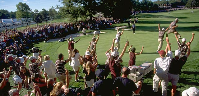 The U.S. team charges the green in celebration after Justin Leonard hit a 45-foot putt at Brookline to win the '99 Cup.