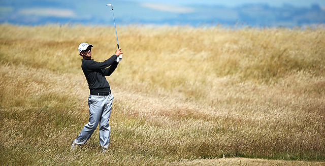 Adam Scott, shown here practicing at Muirfield, gave up a four-shot lead in the final four holes last year at the British Open.