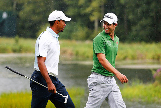 Tiger Woods and Adam Scott play the 16th hole at last August's Deutsche Bank Championship in Norton, Mass.