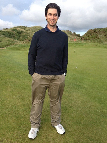 Wearing John Garrity's clothes, but his own sneakers, Alan Shipnuck at Royal Birkdale.