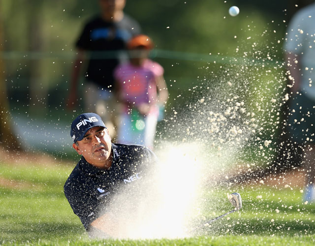 Angel Cabrera blasts out of a greenside bunker on the ninth during the second round of the Wells Fargo Championship.