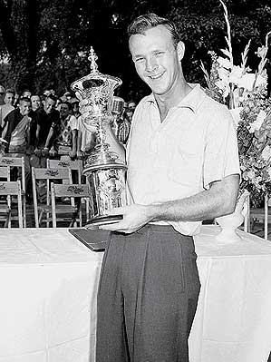 Palmer poses with the U.S. Amateur trophy.