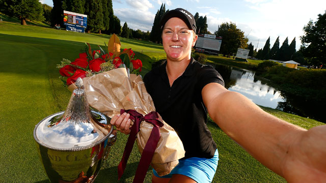 Austin Ernst snaps a selfie with the trophy following her victory at the LPGA Tour's Portland Classic.