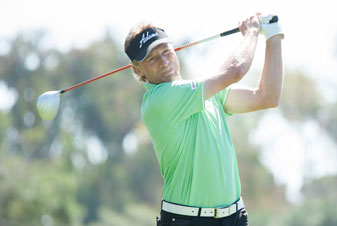 Bernhard Langer watches his drive on the second tee during the first round of the Toshiba Classic.