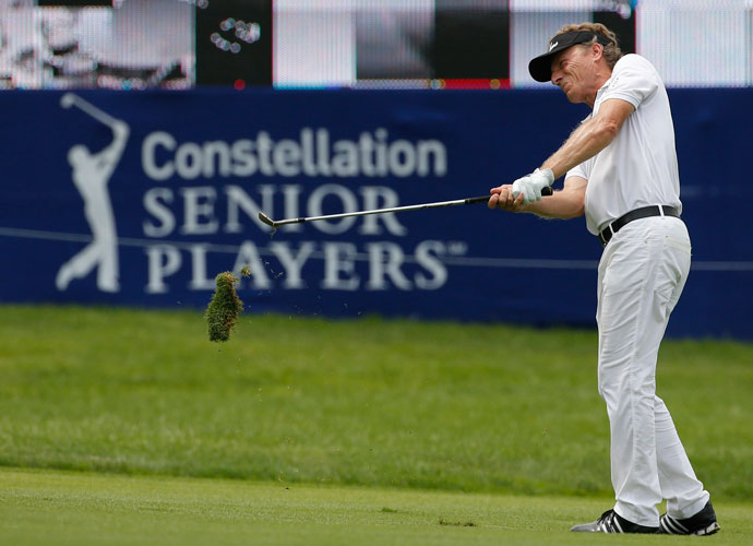 Bernhard Langer hits his approach shot to 18th green during the second round of the Senior Players Championship.