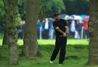 Thomas Bjorn hits an approach shot during his record-tying 62 in the first round of the BMW PGA Championship at Wentworth.