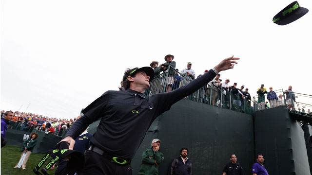 Bubba Watson throws hats to the crowd on the 16th hole during the second round of the Waste Management Phoenix Open. He shot 66 to get to -12 for tournament.