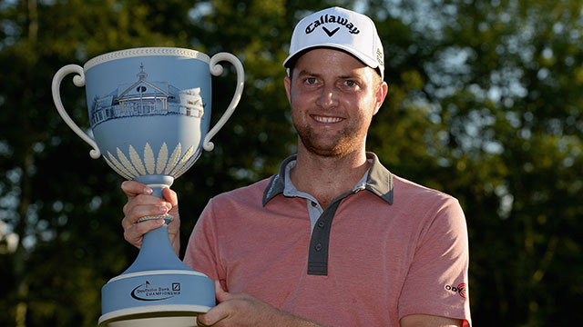 Chris Kirk hoists the trophy following his victory at the Deutsche Bank Championship.
