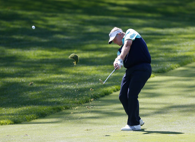Colin Montgomerie hits a shot from the 12th fairway during the third round of the 2014 Senior PGA Championship.