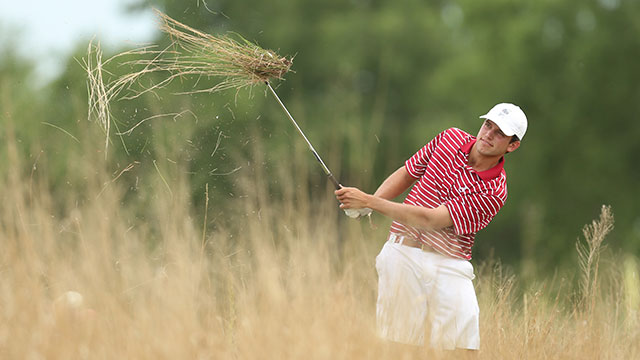 Cory Whitsett, one of three seniors on the Crimson Tide squad, chips out of the rough on the 7th hole.