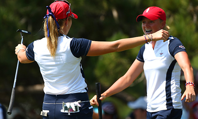 Stacy Lewis teamed with Paula Creamer Saturday morning to earn her first point at the 2013 Solheim Cup.