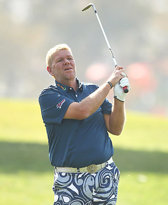 John Daly said he may have torn elbow ligaments in his opening round in India.