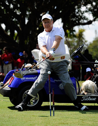Dennis Walters hits a drive from his specialized golf cart during a junior golf clinic for The First Tee at Doral in 2011.