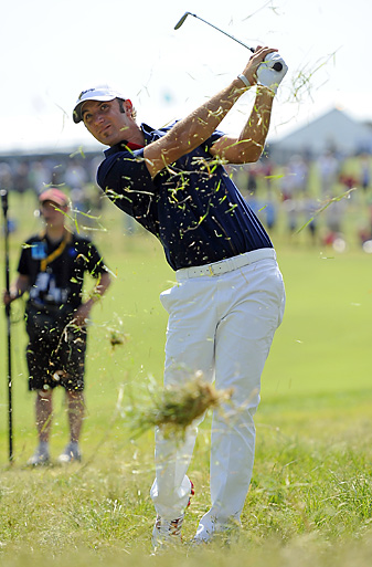 Dustin Johnson teamed with Matt Kuchar to salvage a half-point in his opening match.