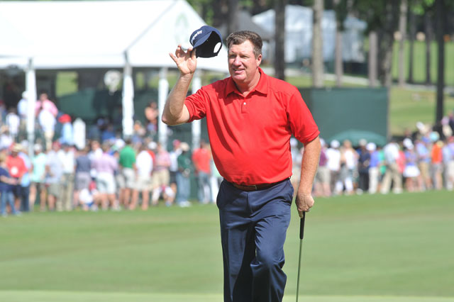 Steve Elkington tips his cap after a birdie May 17 at The Regions Tradition at Shoal Creek Country Club in Alabama.