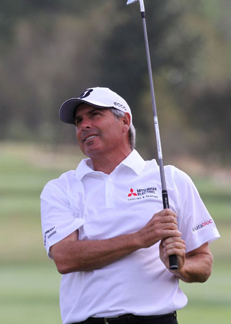 Fred Couples watches his approach shot on the ninth hole during the first round of the Mississippi Gulf Resort Classic at Fallen Oak in Saucier, Miss. He has a two-stroke lead after the first round of the PGA Champions Tour event.