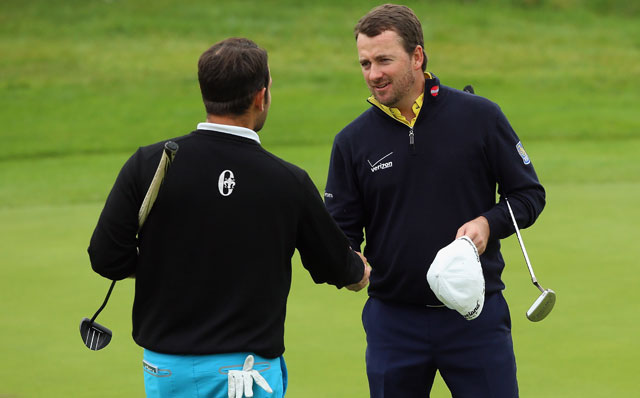 Graeme McDowell shakes hands with Alexander Levy after his 3 and 2 victory in the first round of the Volvo World Match Play Championship.