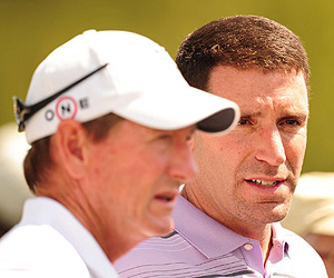 Most golf fans recognize Tiger Woods's swing coach, Hank Haney (left), but Mark Steinberg often blends into the background.