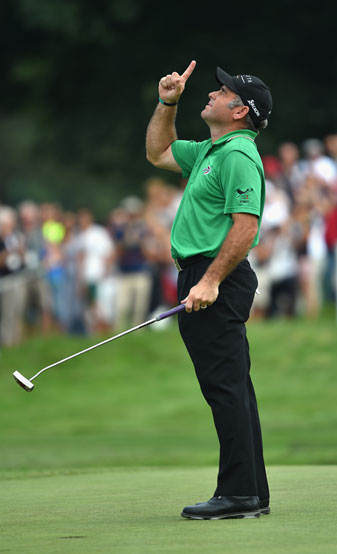 Hennie Otto celebrates on the 18th green after winning the 2014 Italian Open.