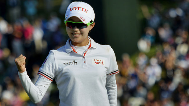 Hyo-Joo Kim celebrates on the 18th following the final round of the Evian Championship.