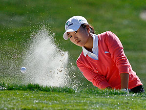Kim found the sand on the ninth hole, but her 69 gave her a one-shot lead going into Sunday.
