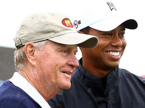 Tiger Woods, right, is four majors away from tying Jack Nicklaus's record of 18.