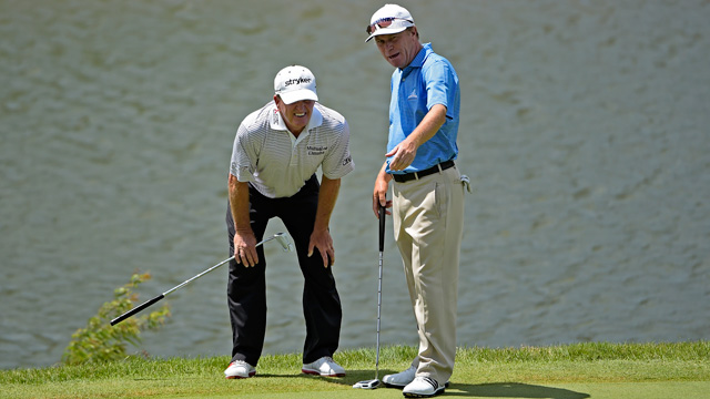 Fred Funk and Jeff Sluman line up a putt during the second round on Saturday.