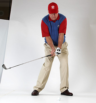 When you swing, get the butt of the club even with your center line (pictured), then release the clubhead, brushing the grass in front of the line.