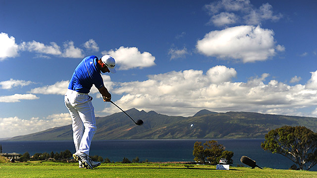 Dustin Johnson tees off in the third round of the Tournament of Champions at Kapalua.