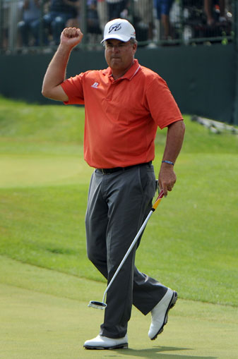 Kenny Perry celebrates his victory on the 18th green.