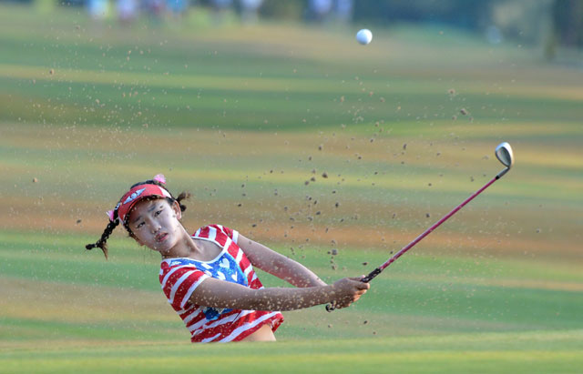 Eleven-year-old Lucy Li blasts out of a bunker on the 10th hole in the opening round of the U.S. Open.