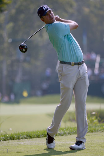Matt Kuchar tees off during a practice round at Valhalla Golf Club prior to the start of the PGA Championship.