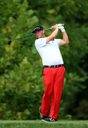 Club pro Michael Block tees off on the fourth hole during the first round of the PGA Championship.