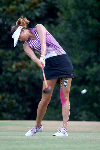 Hit more fairways by copying U.S. Women's Open champ Michelle Wie, who extends her right arm down the line after impact.