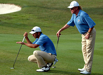 Pablo Larrazabal and Miguel Angel Jimenez of Team Europe line up a shot on the 16th hole during the fourball matches against Team Asia.